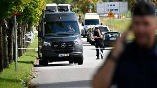 Police stand guard at the scene of an attack at a high school in Eslöv.