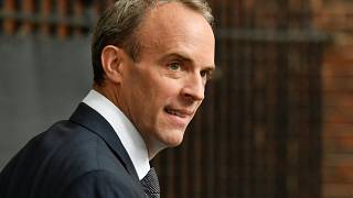 Britain's Foreign Secretary Dominic Raab walks from the Foreign, Commonwealth and Development Office (FCDO) to 10 Downing Street in central London on August 19, 2021.