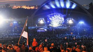 FILE: Estonians gather at Tallinn Song Festival Grounds in Tallinn, Estonia, Saturday, Aug. 20, 2011, to celebrate the 20th anniversary of country's restored independence