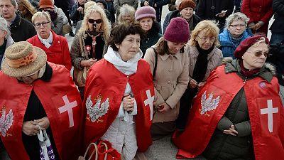 Polish Catholics pray at an anti-gay event in Warsaw, Poland.