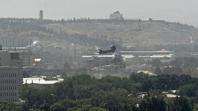 FILE-A US military helicopter is pictured flying above the US embassy in Kabul on August 15, 2021.