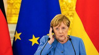 المستشارة الألمانية أنجيلا ميركل خلال مؤتمر صحفيي مشترك مع الرئيس الروسي بعد محادثاتهما في الكرملين في موسكو في 20 أغسطس 2021.