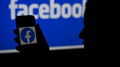 (FILES) In this file photo illustration, a smart phone screen displays the logo of Facebook