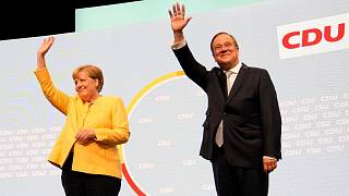 Armin Laschet, the CDU's candidate for chancellor in Germany's September election, right, and outgoing Chancellor Angela Merkel arrive for an event in Berlin.