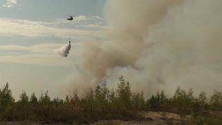 Un de hélicoptères mobilisés dans la lutte anti-incendie dans la république des Maris (Russie), le 21/08/2021 - capture d'écran d'une vidéo de la RTR via Eurovision
