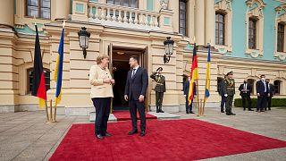 Ukrainian President Volodymyr Zelenskyy, right, greets German Chancellor Angela Merkel during their meeting in Kyiv, Ukraine, Sunday, Aug. 22, 2021.