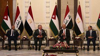 الرئيس العراقي برهم صالح ورئيس الوزراء مصطفى الكاظمي يستقبلان الرئيس المصري عبد الفتاح السيسي والعاهل الأردني الملك عبد الله الثاني في العاصمة بغداد، 27 حزيران/ يونيو 2021