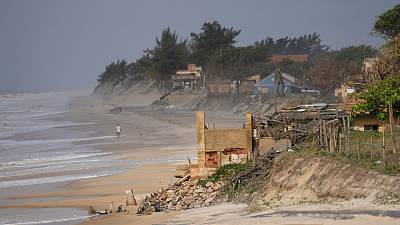 A house destroyed by the sea stand on the beach in Atafona