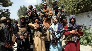 Taliban fighters pose for a photograph in Kabul, Afghanistan