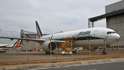 A Boeing 777 bearing the Alitalia livery is parked at Rome's Fiumicino international airport on March 17, 2020.