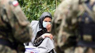 A migrant is pictured after crossing the border from Belarus into the village of Usnarz Gorny in Poland.