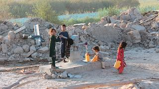 Afghan children fill water containers from a public water tap, Helmand, Aug. 21, 2021