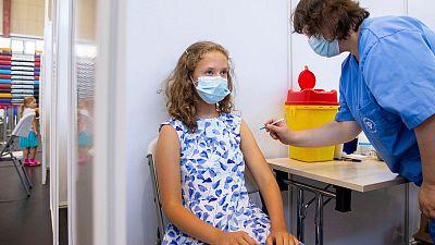 13 year-old Gloria Raudjarv receives a COVID-19 vaccine in Estonia.