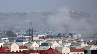 Smoke rises into the air after the explosion at Kabul airport on Thursday