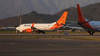 Kam Air planes are parked at Hamid Karzai International Airport in Kabul
