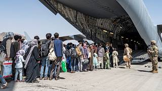Evacuees aboard a US military aircraft at the airport in Kabul, Aug. 21, 2021