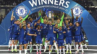 Chelsea's team captain Cesar Azpilicueta lifts the trophy at the end of the Champions League final soccer match between Manchester City and Chelsea in Porto