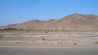 Looking across the Chu from Kyrgyzstan's Chuy Province (the northern Bishkek-Tokmak highway) into Kazakhstan's Zhambyl Province (Korday District).