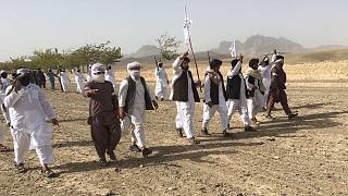 In this Monday, Aug. 15, 2016 photo, Mullah Emdadullah Mansoor, fifth left front, the new leader of the breakaway Taliban faction known as Mahaaz-e-Dadullah