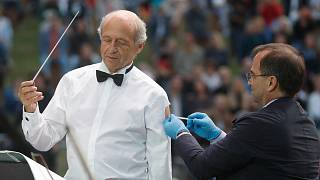 Ivan Fischer receives his third dose of the COVID-19 vaccine as he conducts the orchestra