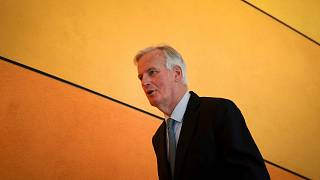 European Union chief Brexit negotiator Michel Barnier arrives for a session at European Parliament in Brussels, Tuesday, April 2, 2019