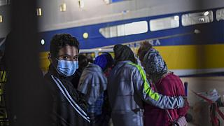 Some 80 unaccompanied minors from the island of Lampedusa's migrant housing center, Sicily, are embarked on the ship Cossyra, Wednesday, May 12, 2021