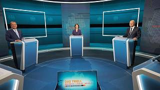 Candidates for chancellor from left, Armin Laschet, Annalena Baerbock and Olaf Scholz stand before the broadcast in the TV studio in Berlin, Sunday, Aug. 29, 2021.