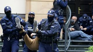 Police removed protestors from outside the Constitutional Tribunal building in Warsaw.