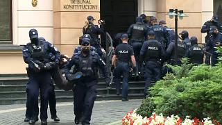 Police drag activists out of court in Poland
