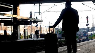A passenger waits for his train at the main station in Duesseldorf, Germany, Tuesday, Aug. 24, 2021