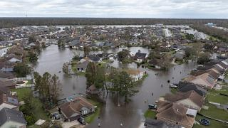 Flooded streets and homes are shown in the Spring Meadow subdivision in LaPlace, La., after Hurricane Ida moved through, Aug. 30, 2021.