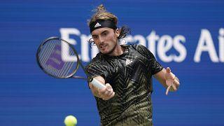 Stefanos Tsitsipas, of Greece, returns a shot to Andy Murray