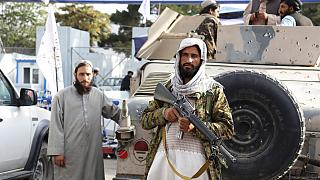 Taliban fighters stand guard in front of the Hamid Karzai International Airport after the U.S. withdrawal in Kabul, Afghanistan, Tuesday, Aug. 31, 2021.