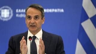 Greece's Prime Minister Kyriakos Mitsotakis speaks during a press conference in Athens, Aug. 12, 2021.