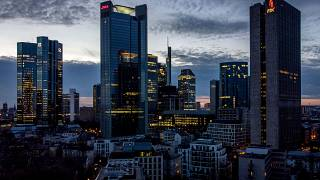 In this Monday, March 29, 2021 file photo, lights burn in some offices of the buildings of the banking district in Frankfurt, Germany.