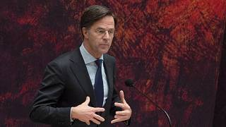 Caretaker Dutch Prime Minister Mark Rutte apologizes to other party leaders during a debate in parliament in The Hague, Netherlands, April 2, 2021.