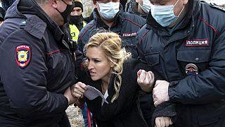 Police officers detain the Alliance of Doctors union's leader Anastasia Vasilyeva at the prison colony IK-2