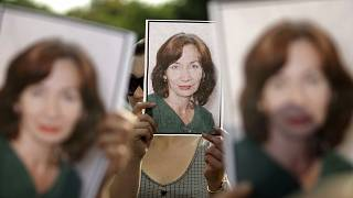 People hold portraits of Natalya Estemirova during a 2009 rally in Moscow.