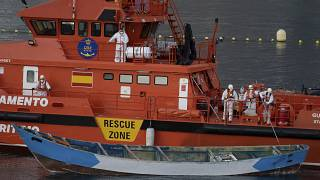 A wooden boat is towed by a Spanish Maritime Rescue Service ship to the port of Los Cristianos in April.
