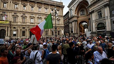 People stage a protest against the COVID-19 vaccination pass in Milan, Italy, Wednesday, July 28, 2021.