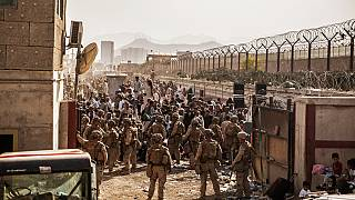 US troops provide assistance during an evacuation at Hamid Karzai International Airport in Kabul