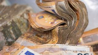 Soaked and mouldy euro banknotes are waiting to be dried at the Bundesbank in Mainz.