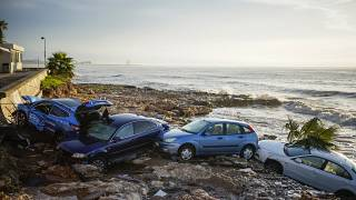 Flash floods swept cars down streets in the Catalan town of Alcanar.