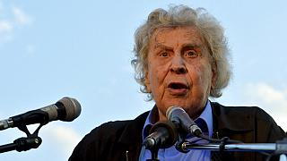 Greek composer Mikis Theodorakis gives a speech to a gathered crowd during a massive peaceful rally against austerity measures on Thursday, June 9, 2011