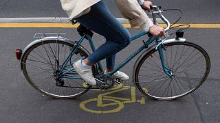 A woman cycles in a so-called pop-up cycling lane in Berlin on June 11, 2020