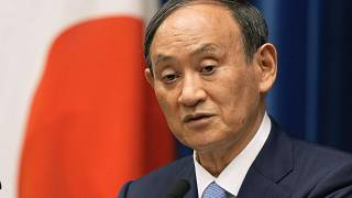 FILE - In this Aug. 17, 2021, file photo, Japanese Prime Minister Yoshihide Suga speaks during a news conference at prime minister's official residence in Tokyo.