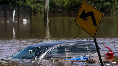 A car flooded on a local street as a result of the remnants of Hurricane Ida is seen in Somerville, New Jersey.