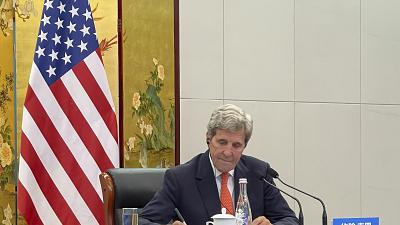 US Special Presidential Envoy for Climate John Kerry attends a meeting with Chinese Foreign Minister Wang Yi via video link in Tianjin, China.