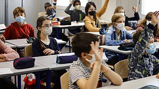 In this Sept. 2, 2021, file photo, children sit in a classroom at school in Strasbourg, eastern France.
