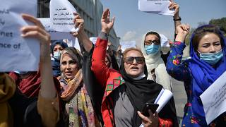 Afghan women take part in a protest march for their rights under the Taliban rule